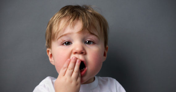 Little boy upset or hurting, toothache or other booboo concept.